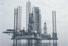 """A jack-up rig can raise and lower itself on three or four massive """"legs."""" Oil companies float these structures out to a drill site and then lower the legs until they touch the sea floor and elevate the rig out of the water."""