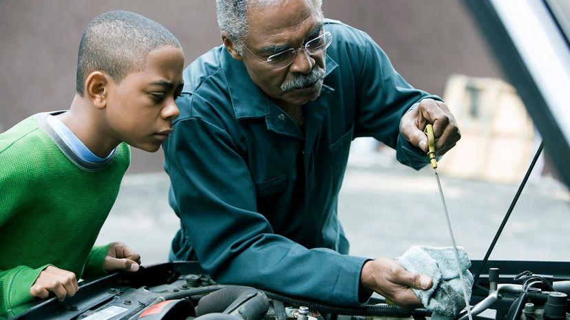 man checking oil