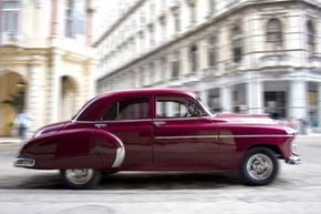 If your older car is perhaps less sprightly than this one, does that mean you can skimp on insurance? See pictures of classic cars.