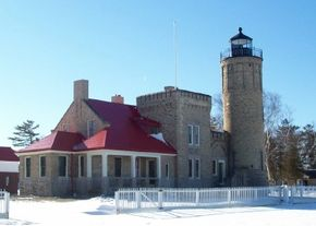 Rising with castle-like walls and turrets, the massive brick Old Mackinac Point lighthouse is one of the more solid and imposing in the Great Lakes region. See more lighthouse pictures.