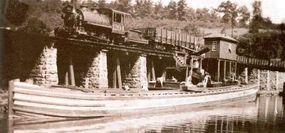 This photograph shows coal being dumped from railroad cars into a waiting canal boat. For transporting minerals, water was still the least expensive option.