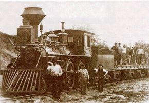 This view captures the unfinished quality of many antebellum railroads. The crew in the foreground is almost certainly American-born; the men on the flat cars are almost certainly immigrants making a dollar or two for a twelve-hour day.