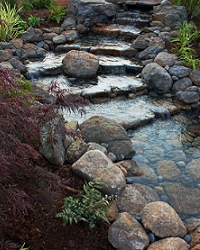 A meandering waterfall maximizes the appearance of a gradual hillside.