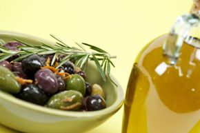Olive oil contains good fats that are healthful for you to consume. See more food pyramid pictures.
