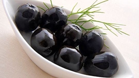 Can olive pits be used as a fuel source?