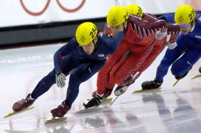 Apolo Anton Ohno (front) of the U.S in action during the short track speed skating 500 meters at the 2006 Turin Games.