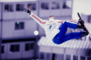 Jonathan Collomb-Patton of France competes in a snowboarding event during the Winter Olympics in Nagano, Japan. This was the first Olympics to feature snowboarding.