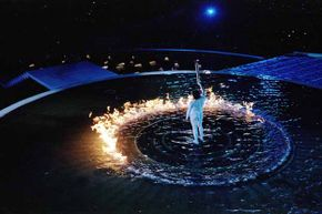 Cathy Freeman of Australia lights the cauldron with the Olympic flame during the opening ceremony of the Sydney Olympics. Freeman was the first torch bearer to also win a gold medal during the Olympics.