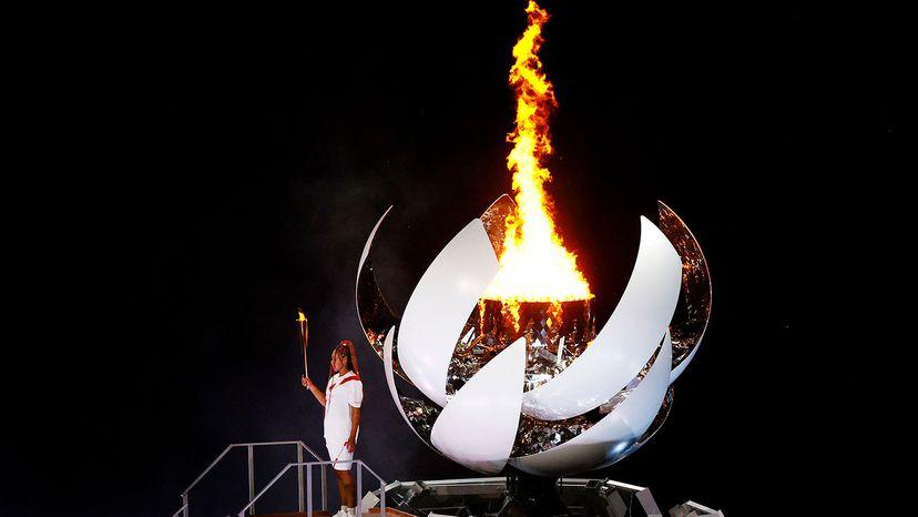 Naomi Osaka lights torch