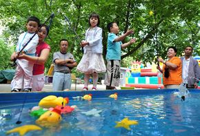Families celebrate Children's Day at a park in Beijing. Children's Day, an annual holiday since 1949, is an important event for a country where most families have only one child. See more pictures of Beijing.