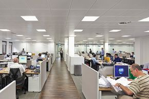 The London office of energy company Saipem is open plan, but people have learned to get their work done.