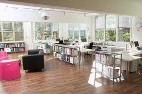 This office has some moveable furniture that can be shifted for private meetings.