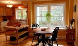 Taking down a wall between a kitchen and dining area makes the space go from two cramped rooms to one grand room.