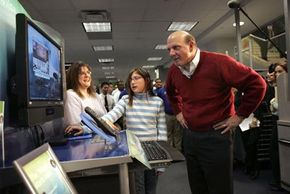 Steve Ballmer, C.E.O. of Microsoft Corporation, watches a customer demonstrate the Windows Vista operating system. See more computer pictures.