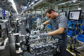 Workers assemble engines for Porsche 911 cars at the Porsche plant in Zuffenhausen, Germany. A complex task, no doubt. Ecomotors estimates that the number of moving parts in its engine has been reduced from 385 to 62, making it much easier to service.