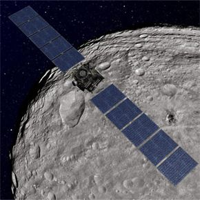 Artist's concept of Dawn orbiting Vesta. Astronomers are pretty interested in whether the massive asteroid could have a violent meet-up with fellow asteroid Ceres.