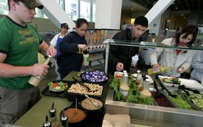 Students at University of California, Berkeley prepare organic salads from the dining commons. UC Berkeley became the first American college campus to offer an organic salad bar prepared by a certified organic kitchen.