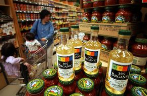 David McNew/Getty Images                              A shopper in Tustin, California walks by certified organic products at Whole Foods Market