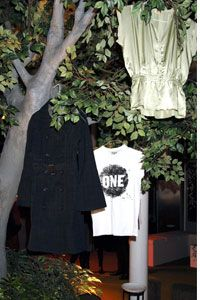 Clothing hangs from a tree at the 2006 launch party of Edun One, a label owned by the rock star Bono and his wife, Ali Hewson, in London.
