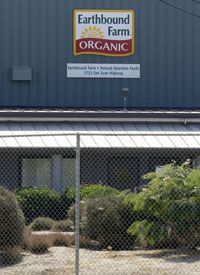 An Earthbound Organic Farm/Natural Selection Foods sign hangs on a building on Sept. 23, 2006 in San Juan Bautista, Calif. With the outbreak of E. Coli being linked by the FDA to bagged spinach from a Natural Selection Foods plant, growers are trying to recoup losses.