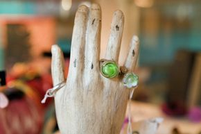 A wooden hand from a mannequin would be awesome to display rings and bracelets.