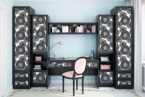 Cabinets and wall shelving can help keep distracting clutter to a minimum.