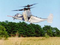 The V-22 Osprey can fly like a helicopter (left) or an airplane (right). See more military jets pictures.