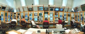 Wide-angle view of the control room of a particle accelerator