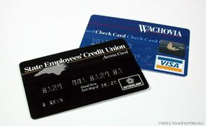 ATM cards and check cards can be used in different ways. See more banking pictures.