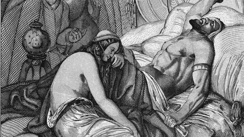 The body of Attila the Hun lies on a bed while his wife of one night, Ildico, weeps at his feet. Kean Collection/Getty Images