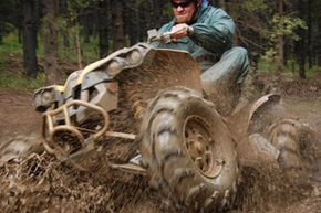It's all fun and games until someone gets stuck in the mud. See more off-roading pictures.