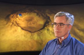 Scientist Chuck Jorgensen uses a subvocal speech-recognition device to move a simulated Mars rover.