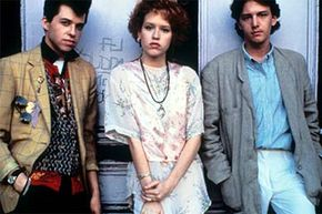 In the film 'Pretty in Pink,' Andie (Molly Ringwald) was originally supposed to end up with Duckie (Jon Cryer, L) but test audiences were rooting for her to get with the more handsome Blaine (Andrew McCarthy, R). The audience prevailed.