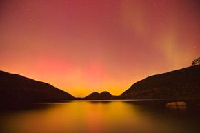 The aurora borealis over a pond in Acadia National Park, Maine