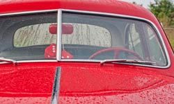 Glass is used for windshields to protect passengers from the elements and potential flying objects.