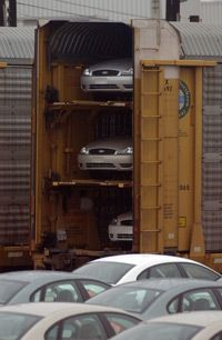 Cars are loaded into rail cars at Ford production plant in Hapeville, Georgia.