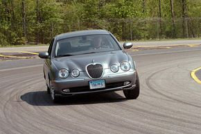 Image Gallery: Car Safety A vehicle test driver drives a Jaguar sedan around the company's test track in East Haddam, Conn. See more car safety pictures.
