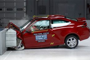 Image Gallery: Car Safety A 2009 2-door Ford Focus is seen in a 40 MPH frontal offset test at the IIHS test center in Virginia. See more car safety pictures.