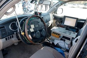 Vehicles being tested in the U.S. Department of Transportation's National Highway Traffic Safety Administration's new dynamic rollover test are controlled by computer for accuracy, as is demonstrated in this 2003 Toyota 4Runner.