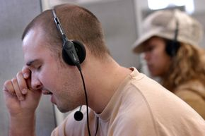 Each telemarketer at a call center needs his own telephone with a headset connected to a dedicated phone line for automatic dialers to work properly.