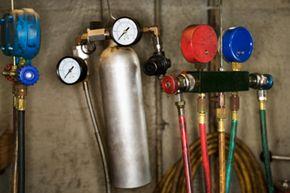 An assortment of automotive air conditioning gauges