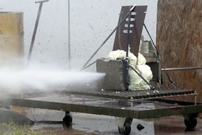 A stream of water blasts through a compilation of steel, concrete block and polystyrene foam during a demonstration at the University of Missouri-Rolla's High Pressure Waterjet Laboratory in Rolla, Mo.