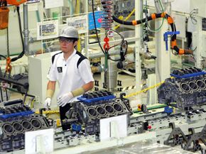 A Toyota Motor Corp. employee works on Lexus engines at the Japanese automaker's flagship production line for luxury Lexus models in Tahara, Japan.