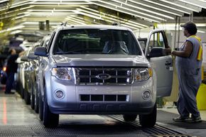 Image Gallery: Hybrid Cars Ford Escape SUVs roll off the line at Ford's Kansas City Assembly Plant in Claycomo, Mo. See more pictures of hybrid cars.