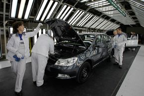Russian workers assemble cars at the Volkswagen AG assembly plant in Kaluga, Moscow.
