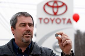 Image Gallery: Car Safety Dan Daigle, service manager at Lee Toyota in Topsham, Maine, holds a shim that will be used to repair springs in the gas pedal systems of recalled Toyota automobiles. See more car safety pictures.