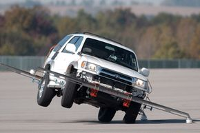 A 2000 Toyota 4Runner lifts its passenger-side wheels while taking part in a dynamic rollover test conducted by the NHTSA at the Transportation Research Center in East Liberty, Ohio.