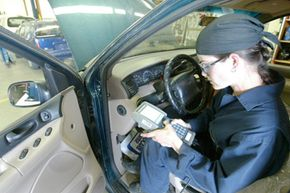 In her Automotive Technology class at Wenatchee Valley College in Wenatchee, Wash., Amber Horn uses a scan tool to check over various systems in a 1995 Ford Windstar on April 14, 2004.