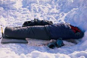 Hypothermic wraps cover people's bodies entirely while being insulated from cold ground.