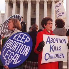 Abortion rights and anti-abortion advocates express opposing viewpoints during a demonstration in Washington, D.C.